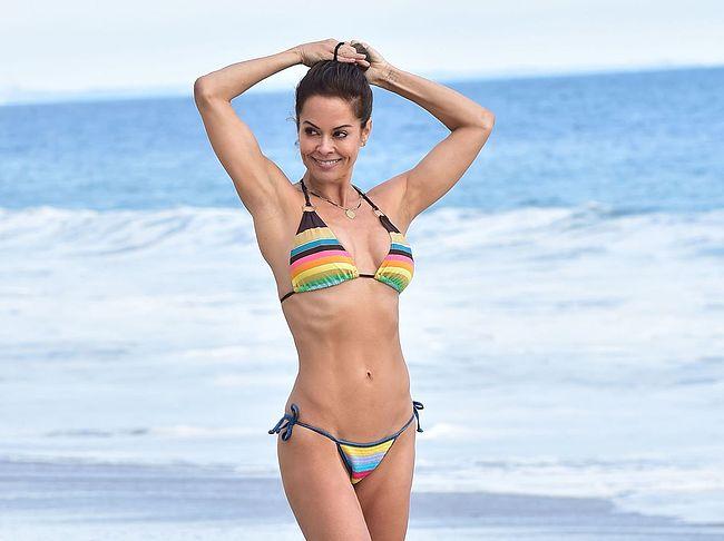 brooke burke shows off her beach body in a colorful bikini