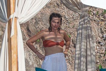 Margot Robbie sunbathing